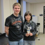 "Thomas with Weiwei on her last day of work. Weiwei took the ""Neil"" prairie dog with her!"