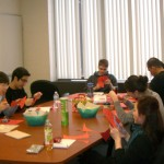 Dr. Lai and her group working on the DNA paper models for the Science Cafe event.