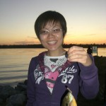 Weiwei showing one of the larger fish she caught that day.