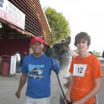 Socrates hanging out with a friendly llama and his handler at the Nebraska State Fair.