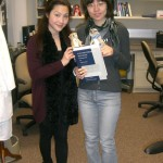 Dr. Lai presented Weiwei with a farewell gift (a Bard Book!) on her last day of work.