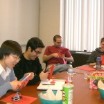Weiwei, Ehsan, Cody and Thomas preparing paper DNA models for Dr. Lai′s Science Cafe presentation.  They looked so happy!