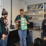 Thomas opening the gift from his labmates.