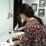 Yao cutting her custom-designed graduation cake.